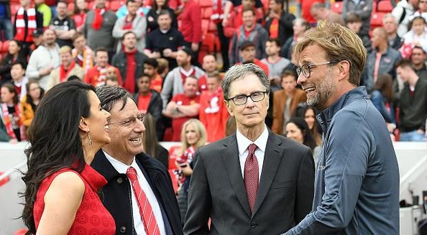 LIVERPOOL, ENGLAND - MAY 21: (THE SUN OUT, THE SUN ON SUNDAY OUT) Tom Werner Chairman of Liverpool poses with Jurgen Klopp manager of Liverpool and John W Henry Principal owner with wife Linda Pizzuti at the end of the Premier League match between Liverpool F.C. and Middlesbrough F.C. at Anfield on May 21, 2017 in Liverpool, England. (Photo by Nick Taylor/Liverpool FC/Liverpool FC via Getty Images)