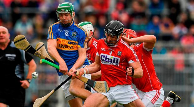 Tipperary's Noel McGrath is put under pressure by Cork trio Colm Spillane, Shane Kingston and Bill Cooper during Cork's shock victory. Photo: Ray McManus/Sportsfile