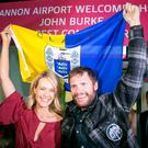 Mountaineering hero John Burke, who runs the Armada Hotel in Miltown Malbay, is welcomed home at Shannon Airport by his wife Aoibhín Garrihy after becoming the first Co Clare man to reach the summit on Mount Everest. Photo: Arthur Ellis