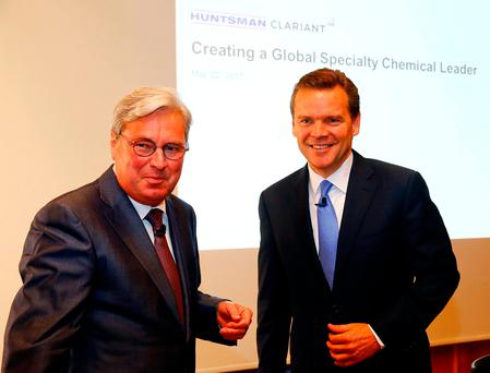 CEO Hariolf Kottmann (L) of Swiss chemical company Clariant and Huntsman President and CEO Peter Huntsman smile after a news conference in Zurich, Switzerland. Photo: Reuters