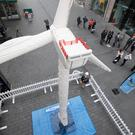 Guinness World Record adjudicator Anna Orford watches as the LEGO Group attempts a World Record for the largest wind turbine made out of LEGO bricks, at Liverpool ONE.