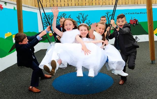Second class pupils at St Brigid's NS, Killygarry, Co Cavan, get into the swing of things at their 'Wear Your Holy Communion Outfit to School' day. Photo: Lorraine Teevan