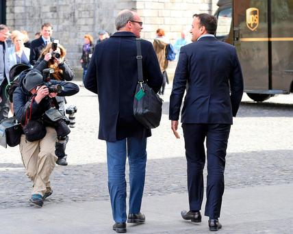Simon Coveney and Leo Varadkar leave inter-party talks in Trinity College, Dublin, in April 2016. Photo: Marc O'Sullivan