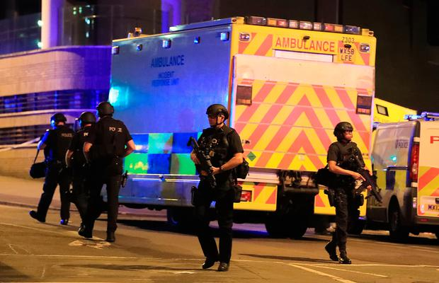 Armed police at Manchester Arena after reports of an explosion at the venue during an Ariana Grande gig. Photo: Peter Byrne/PA Wire