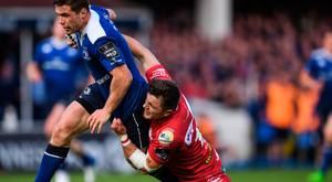 Steff Evans of Scarlets tackles Leinster's Luke McGrath. Photo: Sportsfile