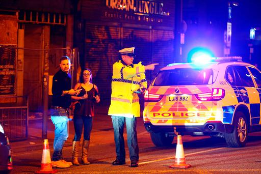 Police stand by a cordoned off street close to the Manchester Arena. Photo: Dave Thompson/Getty Images
