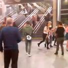 People running through Manchester Victoria station after an explosion at Manchester Arena
