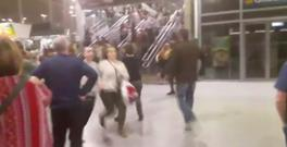People running down stairs as they attempt to exit the Manchester Arena after a blast