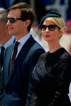 White House senior advisor Jared Kushner (L) and Ivanka Trump, the daughter of US President take part in a welcome ceremony upon the US President's arrival at Ben Gurion International Airport in Tel Aviv on May 22, 2017, as part of his first trip overseas. / AFP PHOTO / MANDEL NGANMANDEL NGAN/AFP/Getty Images