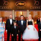 (L-R) Cast members Barry Keoghan, Raffey Cassidy, director Yorgos Lanthimos, cast members Sunny Suljic, Colin Farrell, Nicole Kidman, producer Ed Guiney, and actor Andrew Lowe pose. REUTERS/Stephane Mahe
