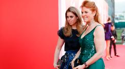Sarah Ferguson, Duchess of York (R) and Princess Beatrice of York attend the Fashion for Relief event during the 70th annual Cannes Film Festival at Aeroport Cannes Mandelieu on May 21, 2017 in Cannes, France. (Photo by Tristan Fewings/Getty Images)