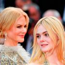 Nicole Kidman (L) and US actress Elle Fanning pose as they leave on May 21, 2017 following the screening of the film 'How to talk to Girls at Parties' at the 70th edition of the Cannes Film Festival in Cannes, southern France. / AFP PHOTO / Alberto PIZZOLIALBERTO PIZZOLI/AFP/Getty Images