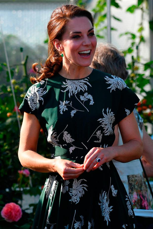 Britain's Catherine, Duchess of Cambridge, reacts after trying a tomato at the 'BBC Radio 2: Chris Evans Taste Garden' during her visit to the Chelsea Flower Show in London on May 22, 2017