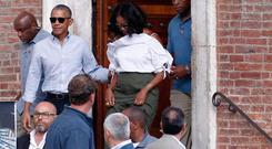 US former President Barack Obama and his wife Michelle leave the Museum of Opera, one of the oldest private museums in Italy, during their visit to Siena, Tuscany region, Italy, Monday, May 22, 2017. The Obamas arrived in Tuscany last Friday for a six-day holiday. (Fabio Di Pietro/ANSA via AP)