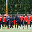 Manchester United's Wayne Rooney stands alongside teammates for a minutes silence in memory of the victims of the Manchester terror attack during the training session at the AON Training Complex in Carrington, ahead of the Europa League Final against Ajax tomorrow evening.