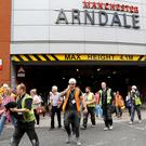 People rush out of the Arndale shopping centre as it is evacuated in Manchester REUTERS/Darren Staples