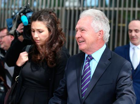 Former Anglo Bank Chairman, Sean Fitzpatrick with his daughter Sarah, after he was acquitted of all charges outside the CCJ court. Picture credit; Damien Eagers