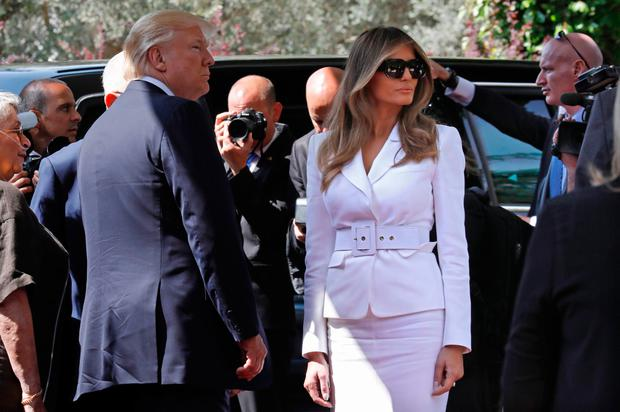 First Lady Melania Trump and US President Donald Trump arrive at the Israeli President's Residence in Jerusalem on May 22, 2017. / AFP PHOTO / GALI TIBBON (Photo credit should read GALI TIBBON/AFP/Getty Images)