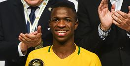 Brazil´s Vinicius Junior poses with the best player trophy in the South American U-17 football tournament in Rancagua, some 90 km south of Santiago de Chile on March 19, 2017. / AFP PHOTO / MARTIN BERNETTI