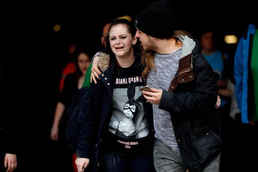 People rush out of the Arndale shopping centre as it is evacuated in Manchester. Photo: REUTERS