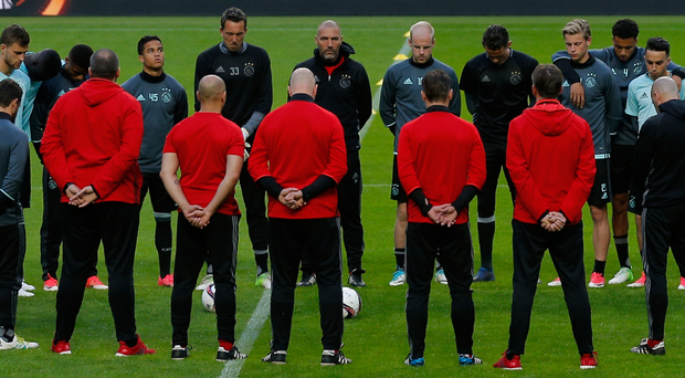 Ajax players stand for a minute's silence at the Friends Arena in Stockholm where tonight's Europa League final will be played. Photo: Reuters