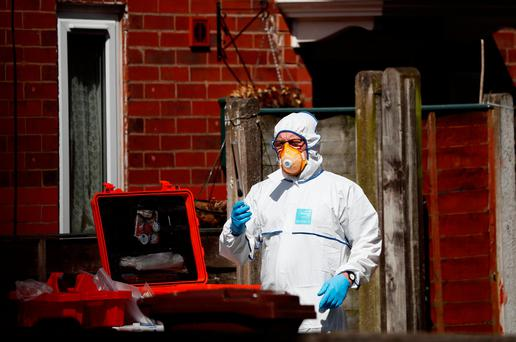 Police investigators work at residential property in south Manchester, England. Photo: REUTERS