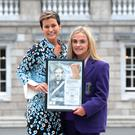 Winner Kate Lynch from Regina Mundi who raised money for Trocaire and Down Syndrome Ireland with Maria Walshe at the Thomas Meagher Foundation and Scholarship awards in Leinster House. Pic: Justin Farrelly.