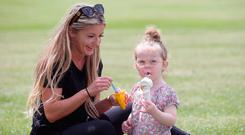 Lyndsey Hatton and her niece, Pippa O'Connor (3), enjoy an ice cream in the Phoenix Park. Photo: Damien Eagers