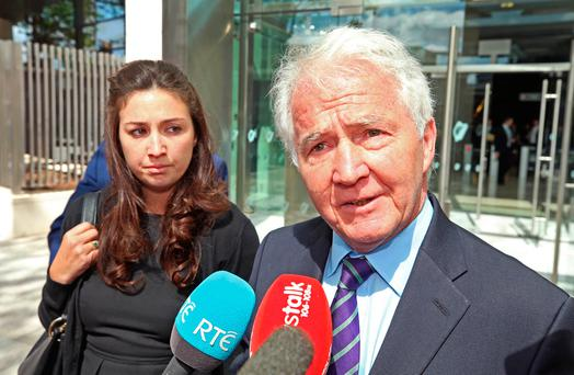Former Anglo Irish Bank chairman Sean FitzPatrick leaves court with his daughter Sarah after he was acquitted of all charges. Photo: Damien Eagers