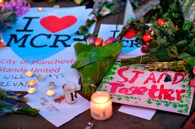 Messages and floral tributes are seen in Albert Square in Manchester. Photo: AFP/Getty Images