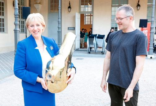 Minister Heather Humphreys holds the Cyclops helmet made by Denis Connolly (right) at the Creative Ireland launch