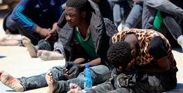 Migrants after being rescued by Libyan coast guards at sea near the capital Tripoli yesterday. Photo: AFP/Getty Images