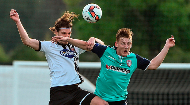 Dundalk's Niclas Vemmelund takes on Derry's Ronan Curtis in an aerial battle Photo: David Maher/Sportsfile