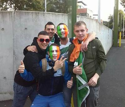 Daryl Dargan (pictured with face paint at back of group) and his cousin Daniel Eremita (pictured with face paint in foreground)