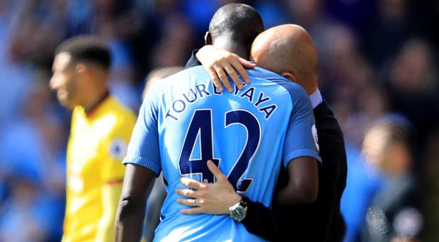WATFORD, ENGLAND - MAY 21: Yaya Toure of Manchester City and Josep Guardiola, Manager of Manchester City speak as he is subtituted during the Premier League match between Watford and Manchester City at Vicarage Road on May 21, 2017 in Watford, England. (Photo by Richard Heathcote/Getty Images)