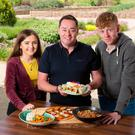 Neven Maguire with Anne Holohan (17) and James Kelly Trant (16) and the dishes they cooked at an al fresco kitchen in Airfield estate. Photograph: ©Fran Veale