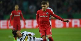 Frankfurt's Uruguayan defender Guillermo Varela and Moenchengladbach's midfielder Marvin Schulz vie for the ball during the German Cup DFB Pokal semifinal football match between Borussia Moenchengladbach and Eintracht Frankfurt in Moenchengladbach, western Germany, on April 25, 2017. / AFP PHOTO / PATRIK STOLLARZ