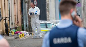 A forensic Garda at the scene on Roche's Row, a laneway between Thomas Street and Roches Street in Limerick. Credit: Liam Burke Press 22