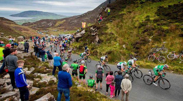 Riders crest the first category ascent of Mamore Gap on stage four of the An Post Rás yesterday. Photo: MORGAN TREACY/INPHO