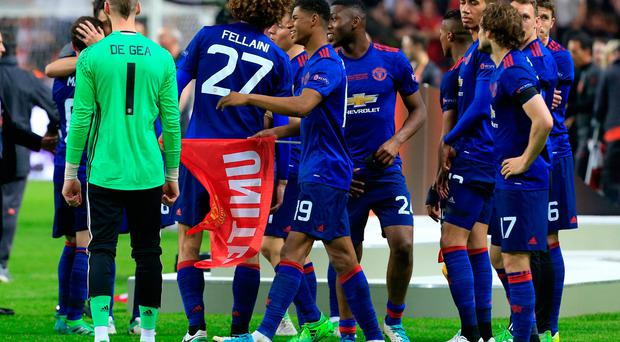 Manchester United players celebrate winning the Europa League after the match