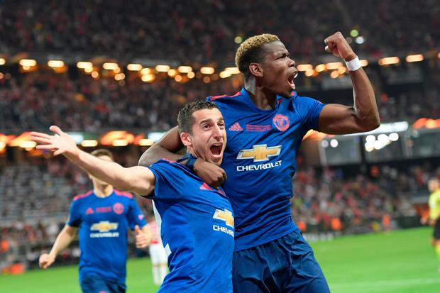 Henrikh Mkhitaryan celebrates scoring Manchester United's second goal with Paul Pogba in last night's Europa League final. Photo: REUTERS