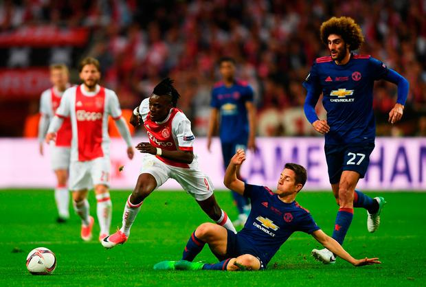 Bertrand Traore is brought down by United's Ander Herrera. Photo: Mike Hewitt/Getty Images