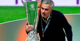 Manchester United manager Jose Mourinho poses with the trophy