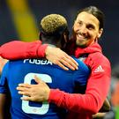 United's Zlatan Ibrahimovic, right, celebrates with teammate Paul Pogba