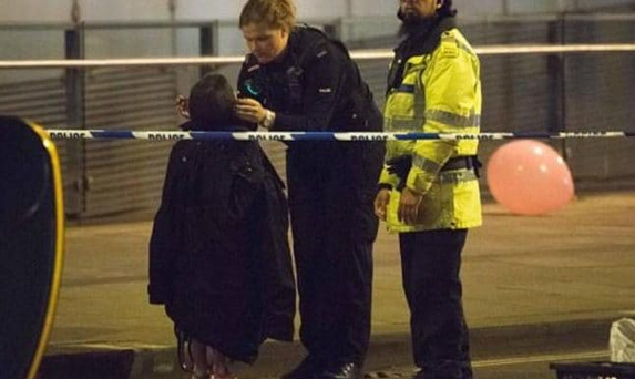 Millie Kiss is comforted by a police officer