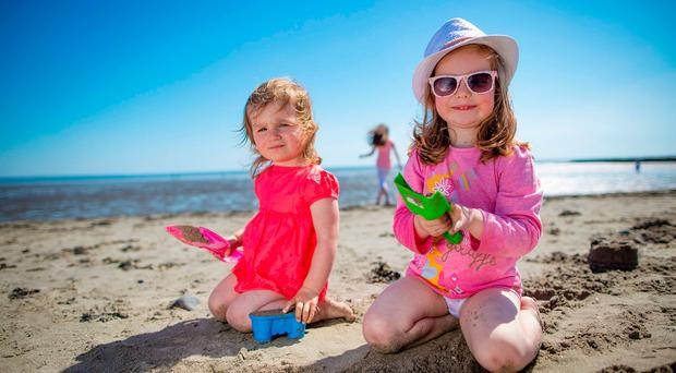 Eve Nugent, age 2 and Abbie Fallon, age 3, Dundalk, enjoying the great weather at Blackrock beach in Co Louth. Picture: Arthur Carron
