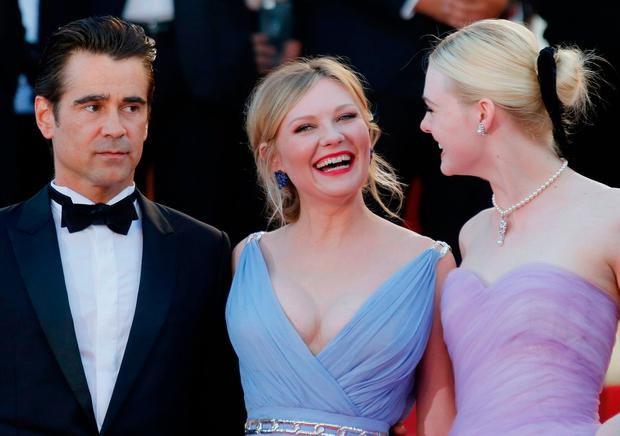 Cast members Colin Farrell, Kirsten Dunst and Elle Fanning and pose at the 70th Cannes Film Festival