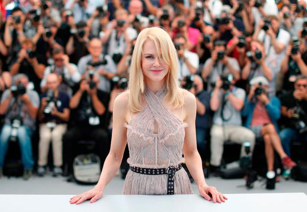 TOPSHOT - Australian actress Nicole Kidman poses on May 24, 2017 during a photocall for the film 'The Beguiled' at the 70th edition of the Cannes Film Festival in Cannes, southern France. / AFP PHOTO / Valery HACHEVALERY HACHE/AFP/Getty Images