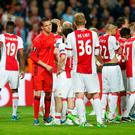 Ajax players look dejected after the match