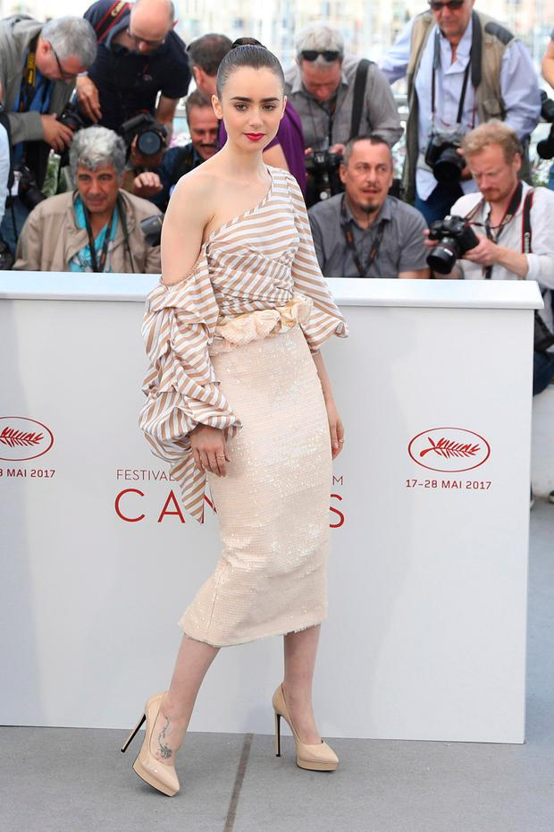 Actress Lily Collins poses for photographers during the photo call for the film Okja at the 70th international film festival, Cannes, southern France, Thursday, May 18, 2017. (AP Photo/Alastair Grant)